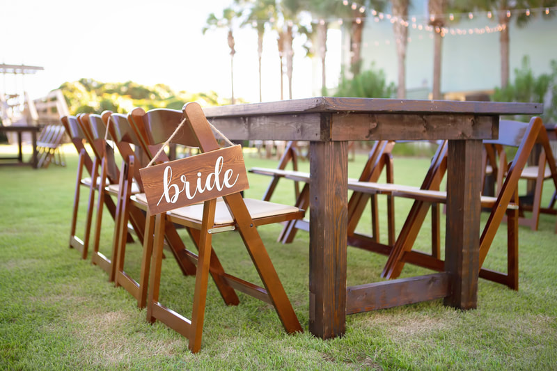 bride's seat at table for wedding reception in sea grove beach. 30a wedding photographer.